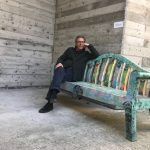 "Collector Mariano Pichler seating on ""Primitive Garden, 2014-16"" by Daniel González"